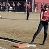 RYAN HUTTON/ Staff photo<br /> Gloucester's Briana Powers taps first to make the out in the top of the fifth inning of Wednesday's home tournament game against Burlington.