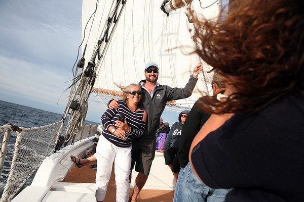 AMY SWEENEY/Staff photo. Captain Heath Ellis poses with guests during the evening sail. The Schooner Thomas E. Lannon took a sail out to watch the start of the Rendez-Vous 2017 Tall Ships Regatta to Canada, off the coast of Rockport.<br /> June 22, 2017