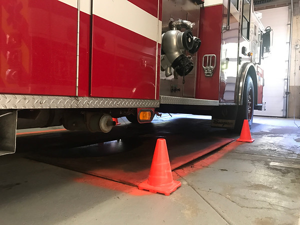 MARY MARCOS/Staff photo<br /> An Essex fire engine is carefully parked over a steel plate covering cracks in the floor of Memorial Station on Martin Street in Essex.