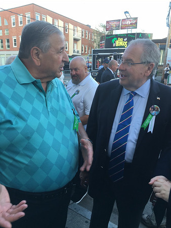 RAY LAMONT/Staff photo<br /> State Speaker of the House Robert DeLeo, right, attending his first St. Peter's Fiesta, speas with resident Vito Calomo, formerly a groundfisherman.