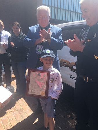 RAY LAMONT/Staff photo<br /> Mason Adams, 6, with Ed McNelley, left, of Cops for Kids with Cancer and Gloucester polic Chief John McCarthy.