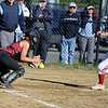 RYAN HUTTON/ Staff photo<br /> Gloucester's Samantha Cominelli catches the ball to make the out at home in the top of the fourth inning of Wednesday's home tournament game against Burlington.
