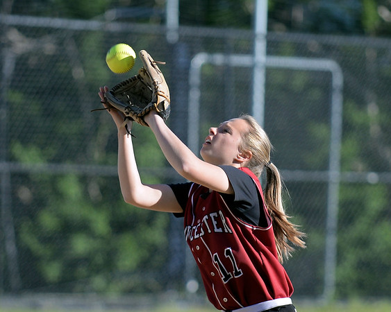 RYAN HUTTON/ Staff photo<br /> Gloucester's Megan Manning snags a fly ball to make the out in the top of the fifth inning of Wednesday's home tournament game against Burlington.