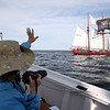 AMY SWEENEY/Staff photo. Guests on the schooner took photos and waved to the other schooners. The Schooner Thomas E. Lannon took a sail out to watch the start of the Rendez-Vous 2017 Tall Ships Regatta to Canada, off the coast of Rockport.<br /> June 22, 2017