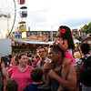 HADLEY GREEN/ Staff photo<br /> People wait in line at the carnival for St. Peter's Fiesta in Gloucester. 6/22/17
