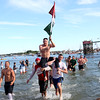 HADLEY GREEN/ Staff photo<br /> Randy Sweet carries the flag up Pavilion Beach after winning Saturday's greasy pole competition. Sweet also won the flag on Friday night. 6/23/17