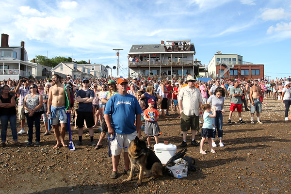 HADLEY GREEN/ Staff photo<br /> People line up on Pavilion Beach in Gloucester for the greasy pole competition at St. Peter's Fiesta. 6/23/17
