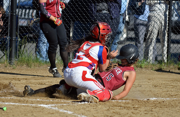 RYAN HUTTON/ Staff photo<br /> Gloucester's Samantha Cominelli slides safely in to home after driving home two other teammates in the bottom of the third inning of Wednesday's home tournament game against Burlington.