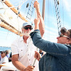 AMY SWEENEY/Staff photo. Capt. Tom Ellis gets some pulling up the sails of The Thomas E. Lannon. The Essex built schooner took a sail out to watch the start of the Rendez-Vous 2017 Tall Ships Regatta to Canada, off the coast of Rockport.<br /> June 22, 2017