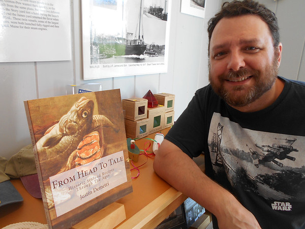 "SEAN HORGAN/Staff photo/Justin Demetri, a Gloucester freelance writera and visitors service director at the Essex Shipbuilding Museum, has published ""From Head to Tale: Historic Seafood Recipes Through the Ages."""