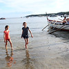 HADLEY GREEN/ Staff photo<br /> Two girls walk in the ocean as Fiesta activities on Pavilion Beach wind down for the day. 6/23/17