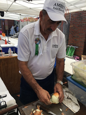 RAY LAMONT/Staff photo<br /> Ambie Scola says the signature Ambie's Sausage sandwiches he and his family served up at St. Peter's Fiesta on Sunday will be his last.