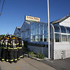 MIKE SPRINGER/Staff photo<br /> Essex firefighters huddle outside the old Fortune Palace restaurant for a talk before going inside for a training exercise Tuesday in Essex. The new owner of the building, John Collins of Hamilton, offered the fire department the opportunity to use the structure for training before it is torn down to make way for a new business.<br /> 6/19/2018