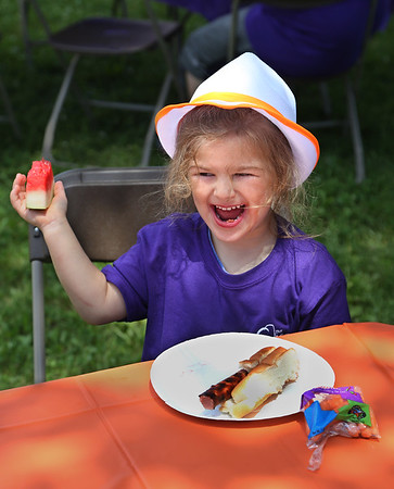 """MIKE SPRINGER/Staff photo<br /> Four-year-old Alana Aiello enjoys her lunch Wednesday at The Open Door's """"Summer Meals for Kids Kick-Off Party"""" at Riverdale Park in Gloucester. The event included music, games, face-panting and a picnic lunch. The free summer meals program for children is offered by The Open Door at nine locations on Cape Ann, plus a new Mobile Summer Meals program in partnership with Project Bread Summer Eats.<br /> 6/20/2018"""