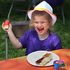 "MIKE SPRINGER/Staff photo<br /> Four-year-old Alana Aiello enjoys her lunch Wednesday at The Open Door's ""Summer Meals for Kids Kick-Off Party"" at Riverdale Park in Gloucester. The event included music, games, face-panting and a picnic lunch. The free summer meals program for children is offered by The Open Door at nine locations on Cape Ann, plus a new Mobile Summer Meals program in partnership with Project Bread Summer Eats.<br /> 6/20/2018"