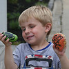 "MIKE SPRINGER/Staff photo<br /> Four-year-old Dax McElhenny looks at a pair of ""Glosta Rocks.""<br /> 6/14/2018"