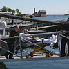 MIKE SPRINGER/Staff photo<br /> A lobsterman from the Gloucester-based Sea Force 1 is wheeled up the ramp at Coast Guard Station Gloucester on Tuesday by Gloucester firefighter/EMTs after he was rescued 12 miles offshore.<br /> 6/19/2018