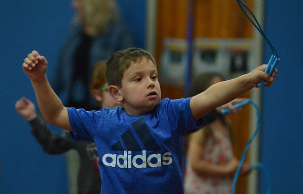 """MIKE SPRINGER/Staff photo<br /> Kindergartner Massimo Chambers participates in a """"World of Rope Jumping"""" program Wednesday at Veterans Memorial Elementary School in Gloucester. The visiting program, led by Mark Rothstein of Sedona, Arizona, incorporates jump roping into lessons on overall cardio-vascular health and character-building.<br /> 6/6/2018"""