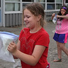 MIKE SPRINGER/Staff photo<br /> Fourth-graders Kassidy Klopotoski, left, and Juliana Marie Knowles learn how to make ice cream by hand in a plastic bag during a year-end science project Thursday at Beeman Memorial Elementary School in Gloucester.<br /> 6/14/2018
