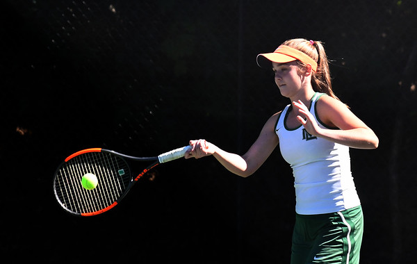 JIM VAIKNORAS/Staff photo Manchester-Essex 1st singlesplayer Olivia Mariotti  in her match against Ursuline Academy's Margaret Daily at Newton North High school Tuesday.