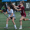 MIKE SPRINGER/Staff photo<br /> Lily Athanas, left, of Manchester Essex controls the ball as Gloucester's Caroline O'Leary plays defense during Division 2 lacrosse first round tournament play Tuesday in Manchester.<br /> 6/5/2018