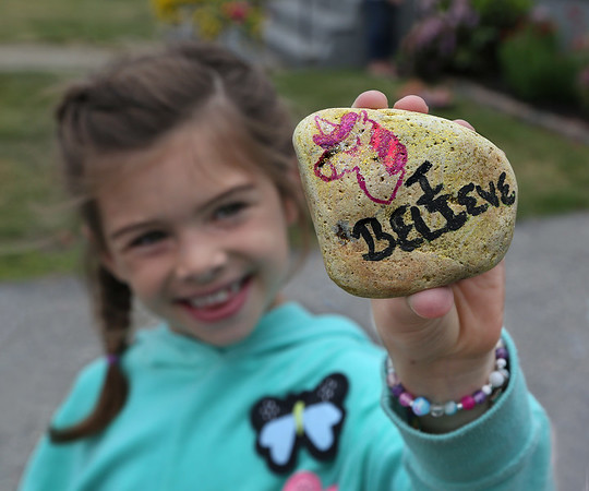 """MIKE SPRINGER/Staff photo<br /> Eight-year-old Daniella Orlando holds a """"Glosta Rock.""""<br /> 6/15/2018"""