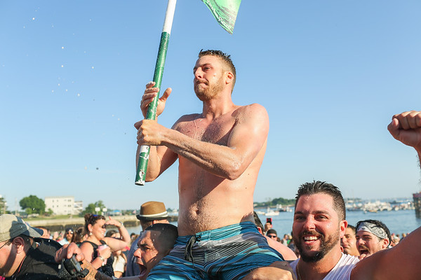 Staff photo/ HADLEY GREEN<br /> <br /> Frank Taormina is carried out of the water after winning Friday night's St. Peter's Fiesta's Greasy Pole competition at Pavilion Beach in Gloucester. <br /> <br /> 06/29/2018