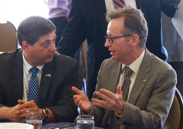 Keynote speaker Jon B. Hurst, right, president of the Retailers Association of Massachusetts, talks with state Sen. Bruce Tarr during the Cape Ann Chamber of Commerce's 38th annual Small Business Week Luncheon on Friday at the Castle Manor Inn in Gloucester.<br /> 6/8/2018