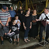 MIKE SPRINGER/Staff photo<br /> Gloucester Fire Chief Eric Smith, right, speaks during a press event Monday with the family of an infant girl born at home June 19 with the help of firefighter-paramedics. In the front row, from left, are father Rick Goulart, newborn daughter Selah, sons Mason, 6, and Braden, 8, mother Amy Goulart, Mayor Sefatia Romeo-Theken, and Chief Smith.<br /> 6/25/2018
