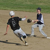 MIKE SPRINGER/Staff photo<br /> Jackson Levendusky of Manchester Essex prepares to slide into second base as Saint Joseph Prep shortstop John O'Dea waits for the ball during Division 4 North first round baseball playoffs Friday in Essex.<br /> 6/8/2018