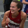 MIKE SPRINGER/Staff photo<br /> Fiona Davis, a Manchester native who graduated this spring from Harvard University, gives the thumbs up Thursday evening after winning the women's event at the Fiesta 5K Road Race in Gloucester.<br /> 7/28/2018
