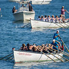 AMANDA SABGA/Staff photo<br /> <br /> Rowgue teammates push the Santa Maria ahead of the Pinta to win during Friday night's St. Peter's Fiesta's women's seine boat race at Gloucester's Pavilion Beach. <br /> <br /> 6/29/18
