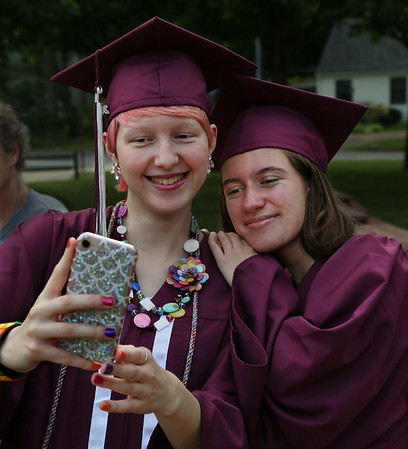 """MIKE SPRINGER/Staff photo<br /> Graduating seniors Samara Houle, left, and Angela Prezzano take a """"selfie"""" together before the start of the 2018 graduation ceremony Friday at Rockport High School. Sixty-seven seniors graduated.<br /> 6/1/2018"""