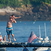AMANDA SABGA/Staff photo<br /> <br /> Frank Taormina approaches the flag during Friday night's St. Peter's Fiesta's Greasy Pole competition at Gloucester's Pavilion Beach. <br /> <br /> 6/29/18