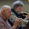 MIKE SPRINGER/Staff photo<br /> Gid Loring, left, of Danvers plays the cornet and Bob Tuffley of Gloucester plays the trumpet Monday with the Good Ol' Salty Jazz Band at the Rose Baker Senior Center in Gloucester. The band, which usually plays at the center on the first three mondays of the month, was founded about 20 years ago by trombonist Al Robinson, who died recently. A special tribute performance for Robinson will be held at 1 p.m. to 3 p.m. on Monday, July 16.<br /> 6/4/2018