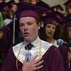 MIKE SPRINGER/Staff photo<br /> Senior class vice president Jakob Wessel leads in the recital of the Pledge of Allegiance during the 2018 graduation ceremony Friday at Rockport High School. Sixty-seven seniors graduated.<br /> 6/1/2018