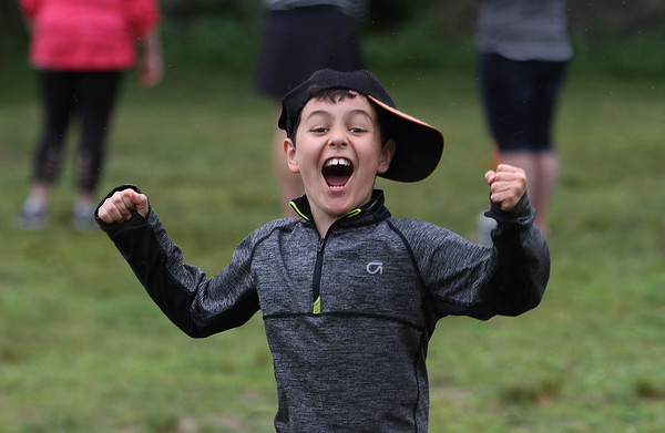 MIKE SPRINGER/Staff photo<br /> Third-grader Logan Frontiero celebrates a victory Friday during the annual year-end field day celebration at East Gloucester Elementary School. Parent volunteers organized a variety of games for the students to play.<br /> 6/15/2018