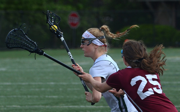 MIKE SPRINGER/Staff photo<br /> Abigail Lantz of Manchester Essex tries to move the ball past Gloucester's Madison Vittands during Division 2 lacrosse first round tournament play Tuesday in Manchester.<br /> 6/5/2018