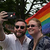 """MIKE SPRINGER/Staff photo<br /> Matthew Murray of Gloucester takes a """"selfie"""" with city counselor Jen Holmgren on Thursday before the rainbow flag raising ceremony in celebration of Gay Pride Month at Gloucester City Hall. More than 50 people attended the event.<br /> 6/7/2018"""