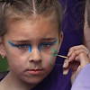 "MIKE SPRINGER/Staff photo<br /> Six-year-old Avery Tavares holds still while her face is being painted Wednesday at The Open Door's ""Summer Meals for Kids Kick-Off Party"" at Riverdale Park in Gloucester. The event included music, dancing, games and a picnic lunch. The free summer meals program for children is offered by The Open Door at nine locations on Cape Ann, plus a new Mobile Summer Meals program in partnership with Project Bread Summer Eats.<br /> 6/20/2018"