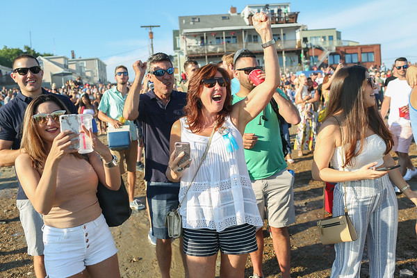 Staff photo/ HADLEY GREEN<br /> <br /> Enza Taormina, Frank Taormina's mom, cheers after her son wins Friday night's Greasy Pole competition. <br /> <br /> 06/29/2018