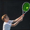 MIKE SPRINGER/Staff photo<br /> Pieter Breuker, Manchester Essex's number one singles player, hits a high backhand during Division 3 North quarterfinal tennis play Wednesday against Hamilton-Wenham at Gordon College in Wenham.<br /> 6/6/2018