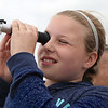 MIKE SPRINGER/Staff photo<br /> Plum Cove fifth-grader Kayla Fogarty uses a refractometer to measure the salinity of seawater during a marine science field trip Wednesday on the schooner Ardelle in Gloucester Harbor. Maritime Gloucester education director Amanda Madeira, right, taught the students that salt refracts or bends light as it passes through water. By measuring the refraction, the fifth graders were able to able to measure the salt level.<br /> 6/13/2018