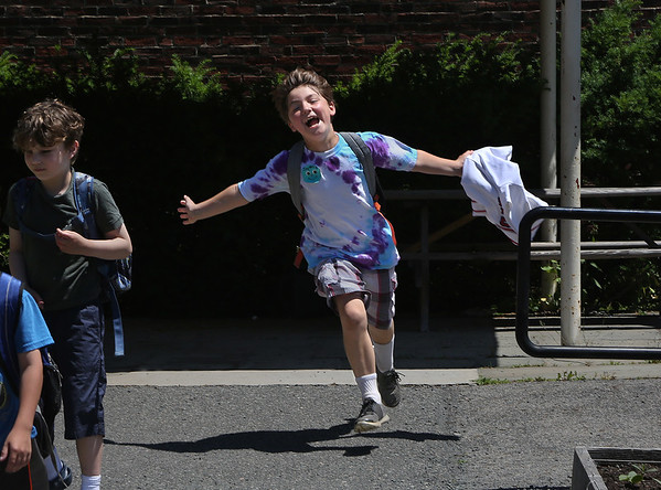 MIKE SPRINGER/Staff photo<br /> Jayden Migliore celebrates the end of fourth grade and the beginning of summer vacation after the final bell Tuesday at Veterans Memorial School in Gloucester.<br /> 6/19/2018