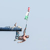 Staff photo/ HADLEY GREEN<br /> <br /> Frank Taormina falls to the water flag in hand during Friday night's St. Peter's Fiesta's Greasy Pole competition at Pavilion Beach in Gloucester. <br /> <br /> 06/29/2018