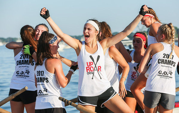 Staff photo/ HADLEY GREEN<br /> <br /> Zoe Venetsanakos cheers after her team Uproar wins the girls seine boat race during Friday night's Fiesta celebration at Pavilion Beach in Gloucester.<br /> <br /> 06/29/2018