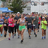 MIKE SPRINGER/Staff photo<br /> Runners pass St. Peter's Square during the Fiesta 5K Road Race Thursday evening in Gloucester.<br /> 6/28/2018