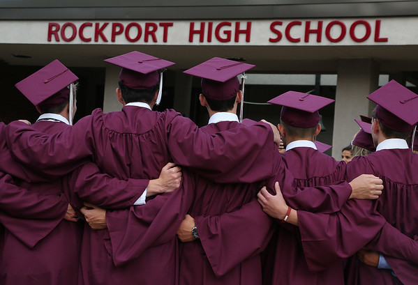 MIKE SPRINGER/Staff photo<br /> A group of graduating seniors pose for a photograph in front of the school before the start of the 2018 graduation ceremony Friday at Rockport High School. Sixty-seven seniors graduated.<br /> 6/1/2018