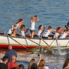 AMANDA SABGA/Staff photo<br /> <br /> Up Roar teammates celebrate their win during Friday night's St. Peter's Fiesta's girls seine bot race at Gloucester's Pavilion Beach. <br /> <br /> 6/29/18