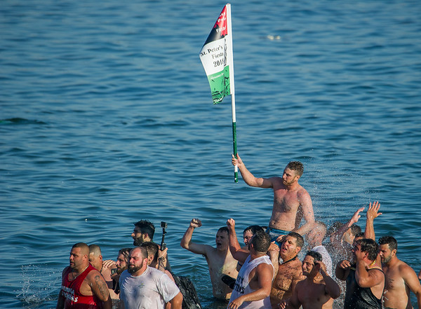 AMANDA SABGA/Staff photo<br /> <br /> Frank Taormina is carried out of the water after retrieving the flag during Friday night's St. Peter's Fiesta's Greasy Pole competition at Gloucester's Pavilion Beach. <br /> <br /> 6/29/18